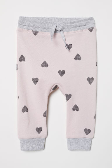 Cotton Joggers - Light pink/hearts - Kids | H&M US
