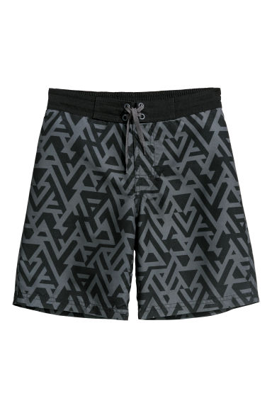 Printed swim shorts - Black/Grey patterned - Kids | H&M CN