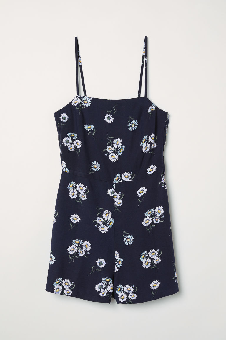 Sleeveless playsuit - Dark blue/Flowers - Ladies | H&M