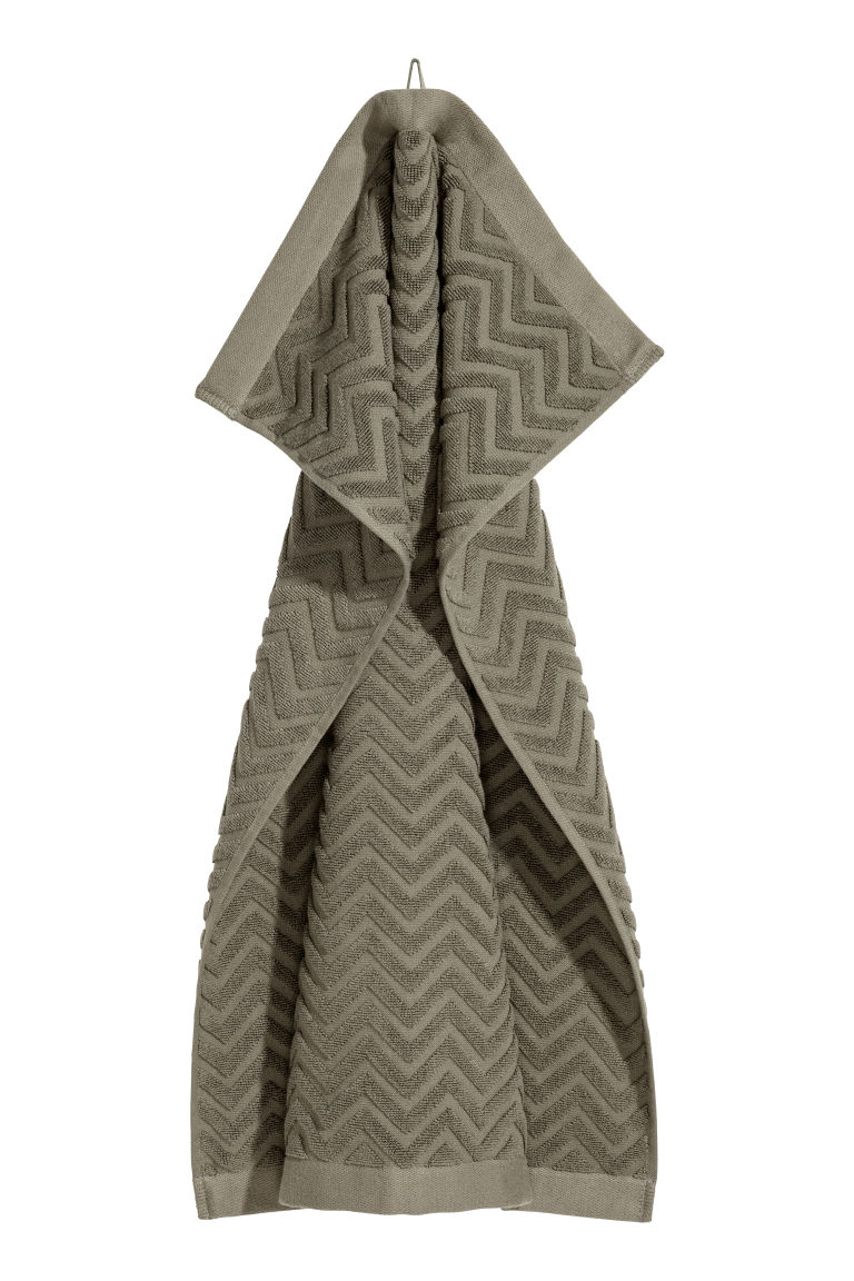 Jacquard-patterned hand towel - Khaki green - Home All | H&M CN