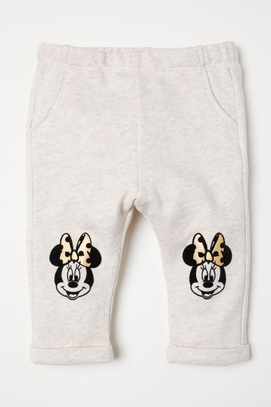 Flock-print sweatpants - Light beige/Minnie Mouse - Kids | H&M CN