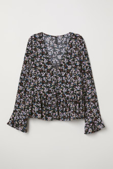 V-neck blouse with buttonsModel