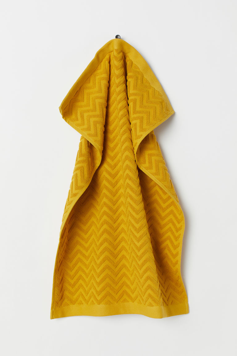 Jacquard-patterned hand towel - Mustard yellow - Home All | H&M GB