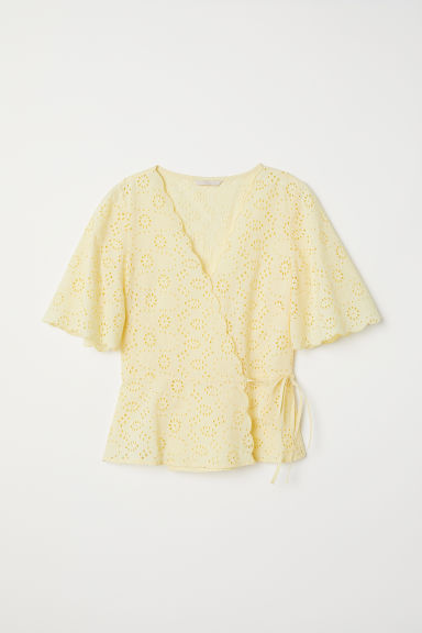 Embroidered wrapover blouse - Light yellow -  | H&M