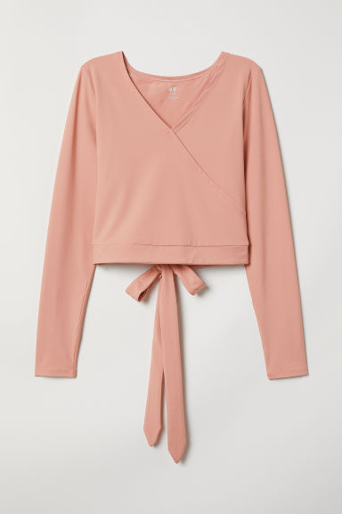 Short yoga top - Powder pink - Ladies | H&M