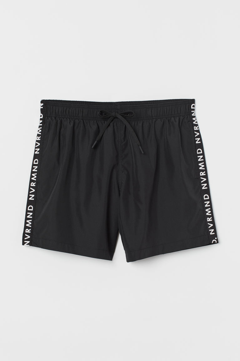 Printed swim shorts - Black/NVRMND - Men | H&M IE