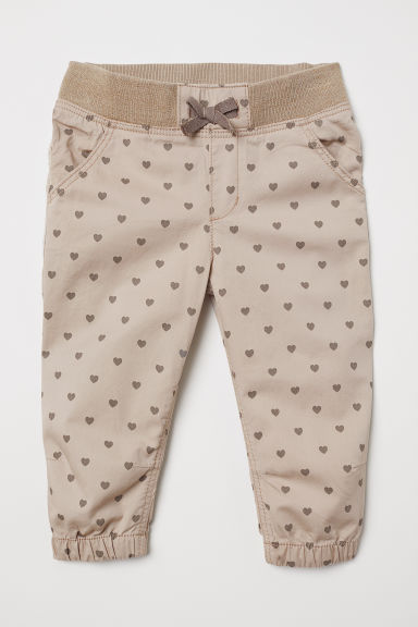 Cotton pull-on trousers - Beige/Hearts - Kids | H&M