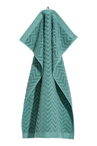 Jacquard-patterned hand towel - Dark turquoise - Home All | H&M CN
