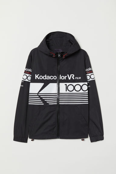 Printed windbreaker - Black/Kodak - Men | H&M CN