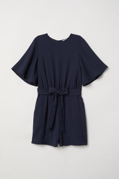 Playsuit with a tie belt - Dark blue - Ladies | H&M CN