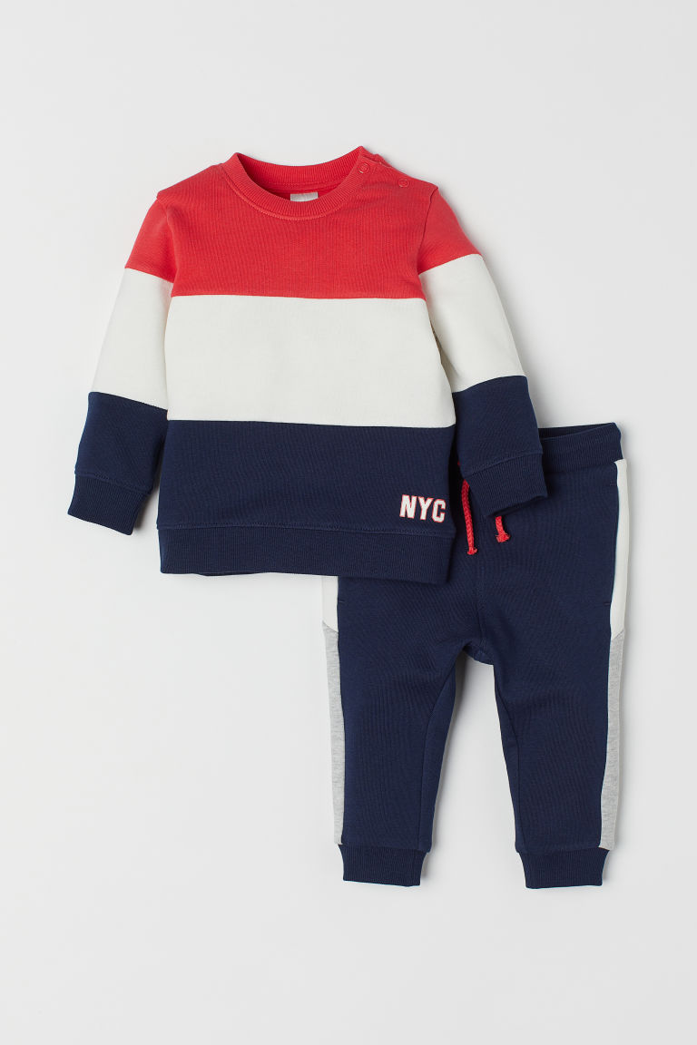 Sweatshirt and trousers - Dark blue/Block-coloured - Kids | H&M CN