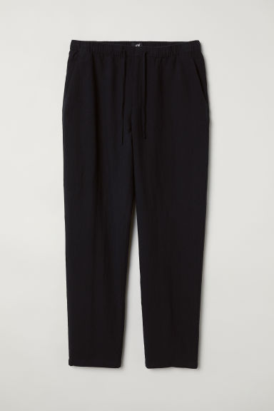 Pantaloni ampi - Nero - UOMO | H&M IT