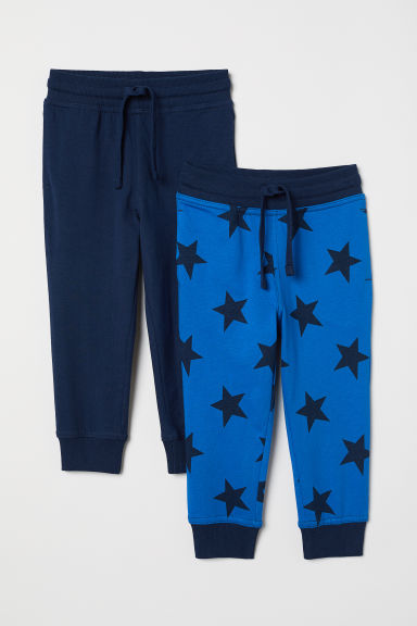 2-pack joggers - Bright blue/Stars - Kids | H&M