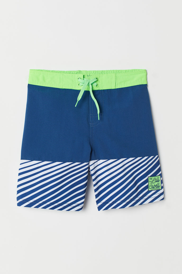 Swim shorts - Dark blue/Neon green - Kids | H&M