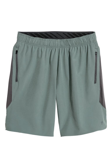 Sports shorts with mesh - Dusky green -  | H&M