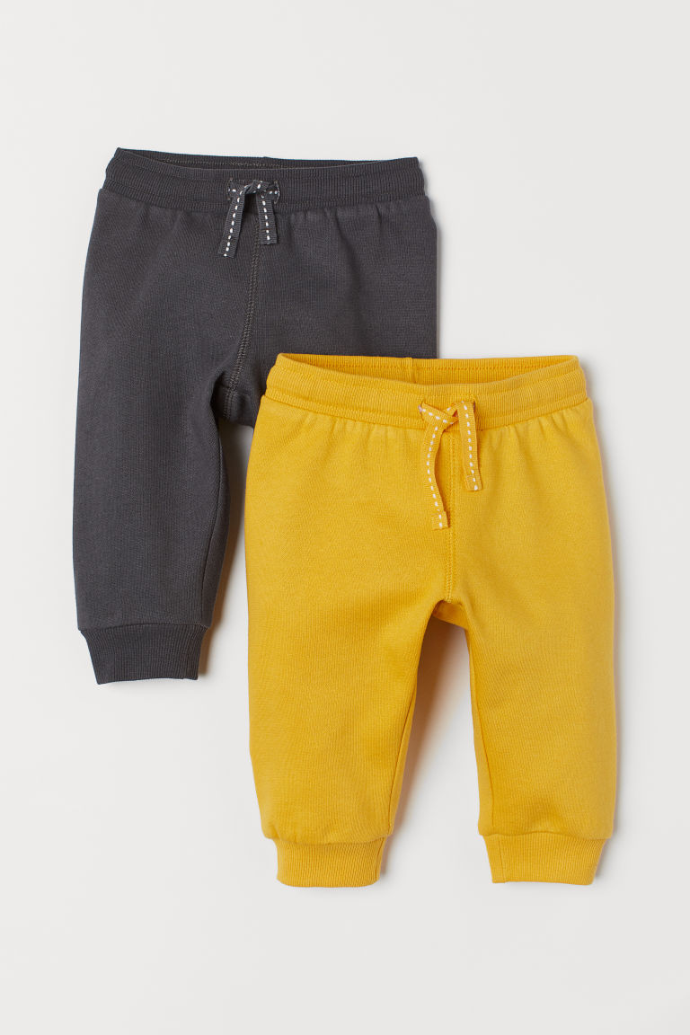 2-pack cotton joggers - Mustard yellow/Dark grey - Kids | H&M