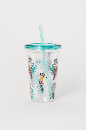 Plastic mug with a straw