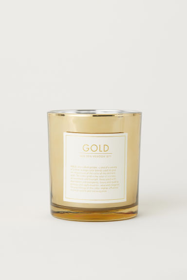 Scented candle in a glass jar - Gold-coloured/Golden Meadow - Home All | H&M IE