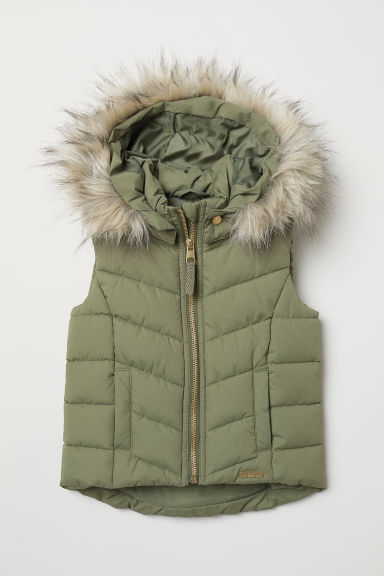 Padded gilet with a hood - Khaki green - Kids | H&M