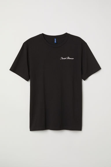 T-shirt with a motif - Black/Santa Monica - Men | H&M