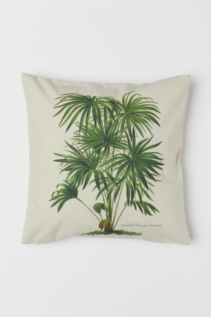 Cushion cover with a motif