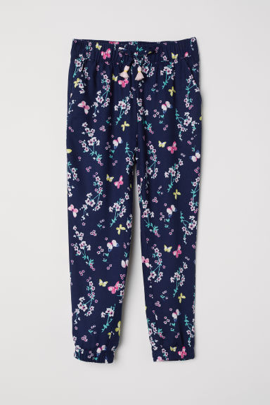 Patterned pull-on trousers - Dark blue/Floral - Kids | H&M