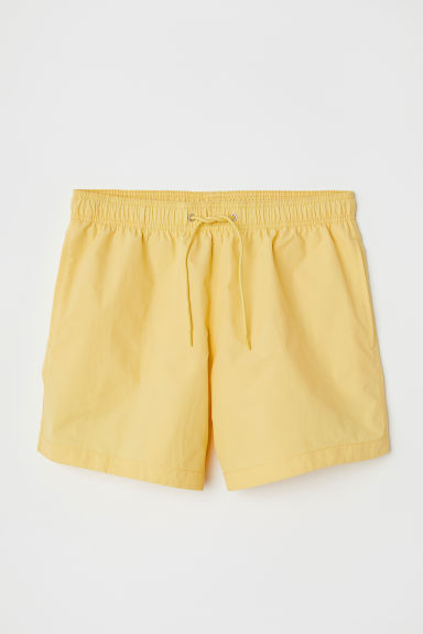 Swim shorts - Light yellow - Men | H&M IE