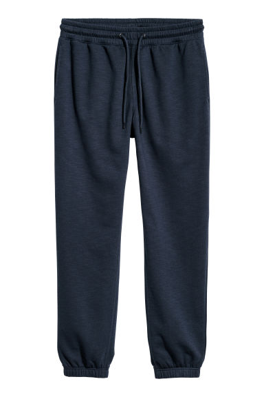 Pantaloni da tuta Regular fit - Blu scuro - UOMO | H&M IT