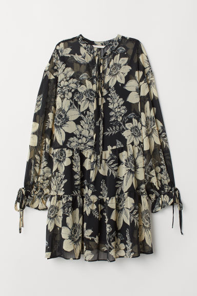 Tunica con volant - Nero/fiori -  | H&M IT