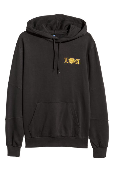 Hooded top with a motif - Black/LA - Men | H&M