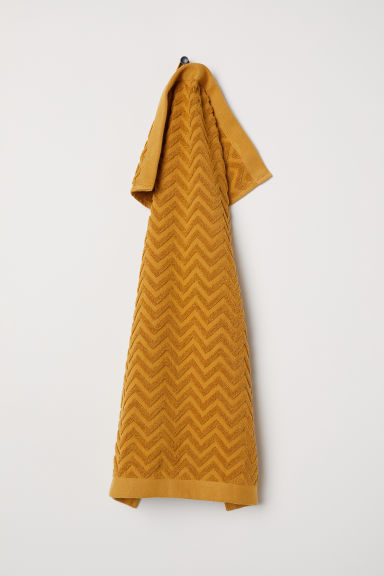 Jacquard-patterned hand towel - Dark mustard yellow -  | H&M CN