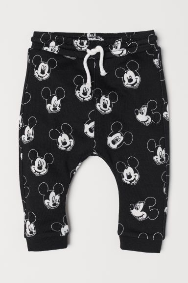 Printed joggers - Black/Mickey Mouse - Kids | H&M CN
