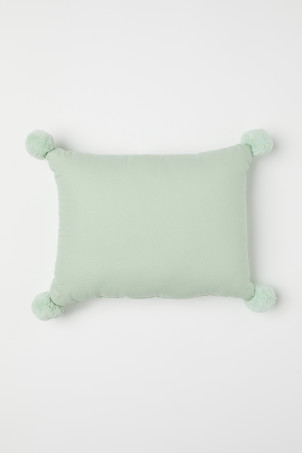 Cushion with pompoms
