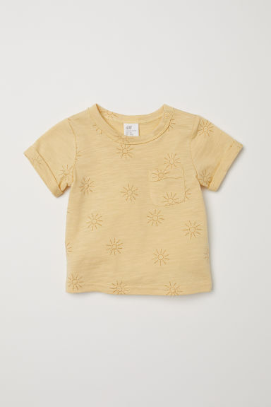 T-shirt with a chest pocket - Light yellow/Sunbursts -  | H&M