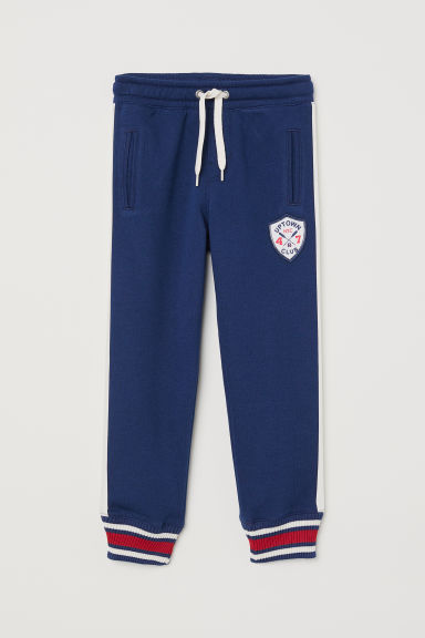 Joggers with an appliqué - Dark blue - Kids | H&M CN