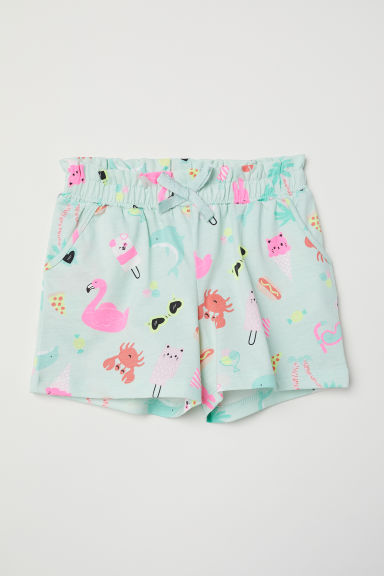 Jersey shorts - Light green/Animals - Kids | H&M CN