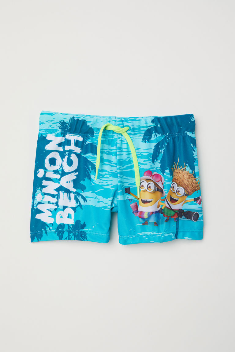 Printed swimming trunks - Dark turquoise/Minions - Kids | H&M IN
