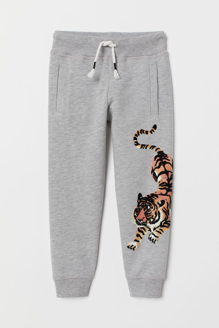 Printed joggers - Grey marl/Tiger - Kids | H&M