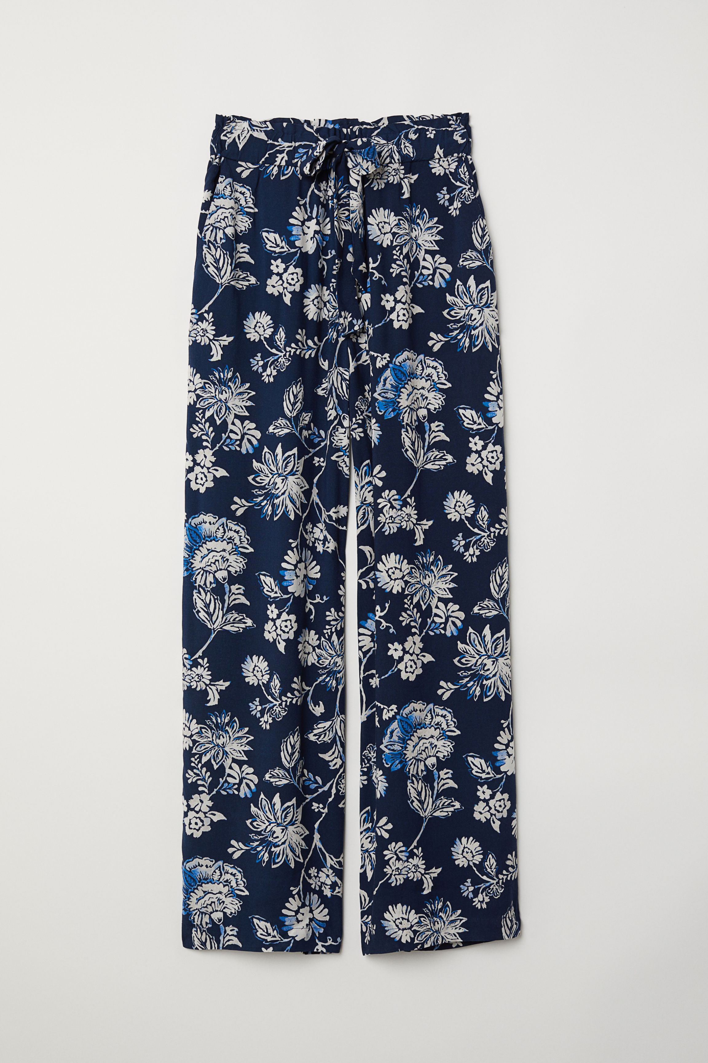 38359a2d6de7e Paper bag trousers - Dark blue/White striped - Ladies   H&M GB