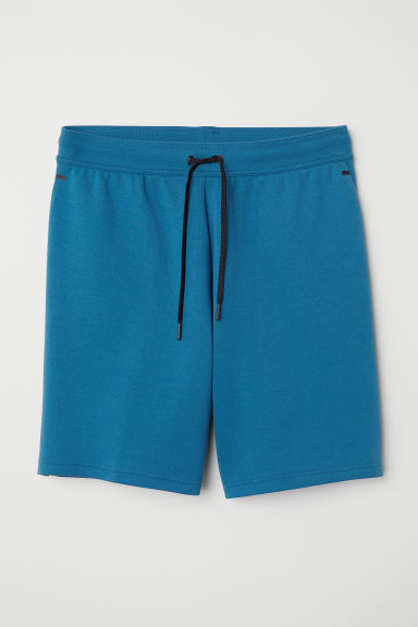 Sports shorts - Turquoise - Men | H&M CN