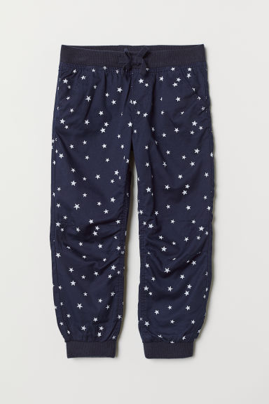 Lined joggers - Dark blue/Stars - Kids | H&M CN