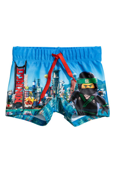 Printed swimming trunks - Blue/Lego - Kids | H&M
