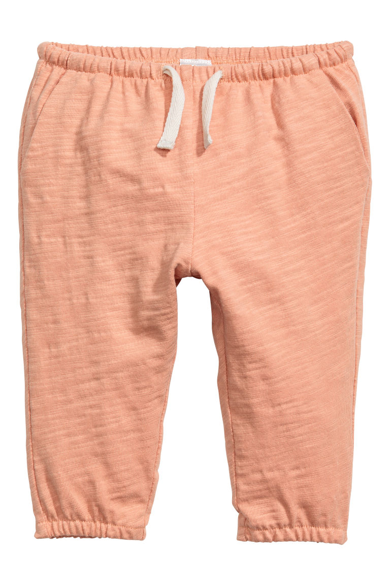 Slub cotton jersey trousers - Apricot - Kids | H&M CN