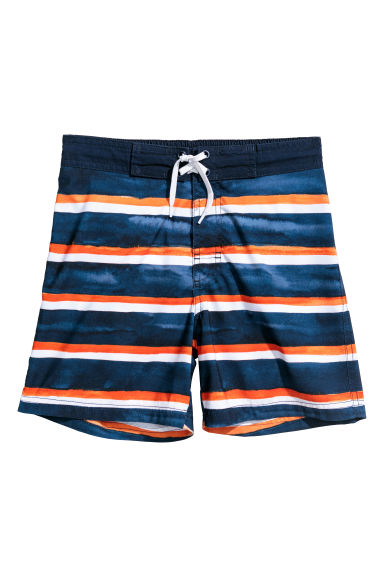 Patterned swim shorts - Dark blue/Orange striped - Kids | H&M GB