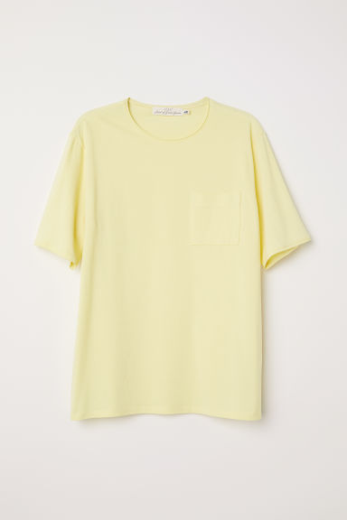 T-shirt with a chest pocket - Light yellow -  | H&M