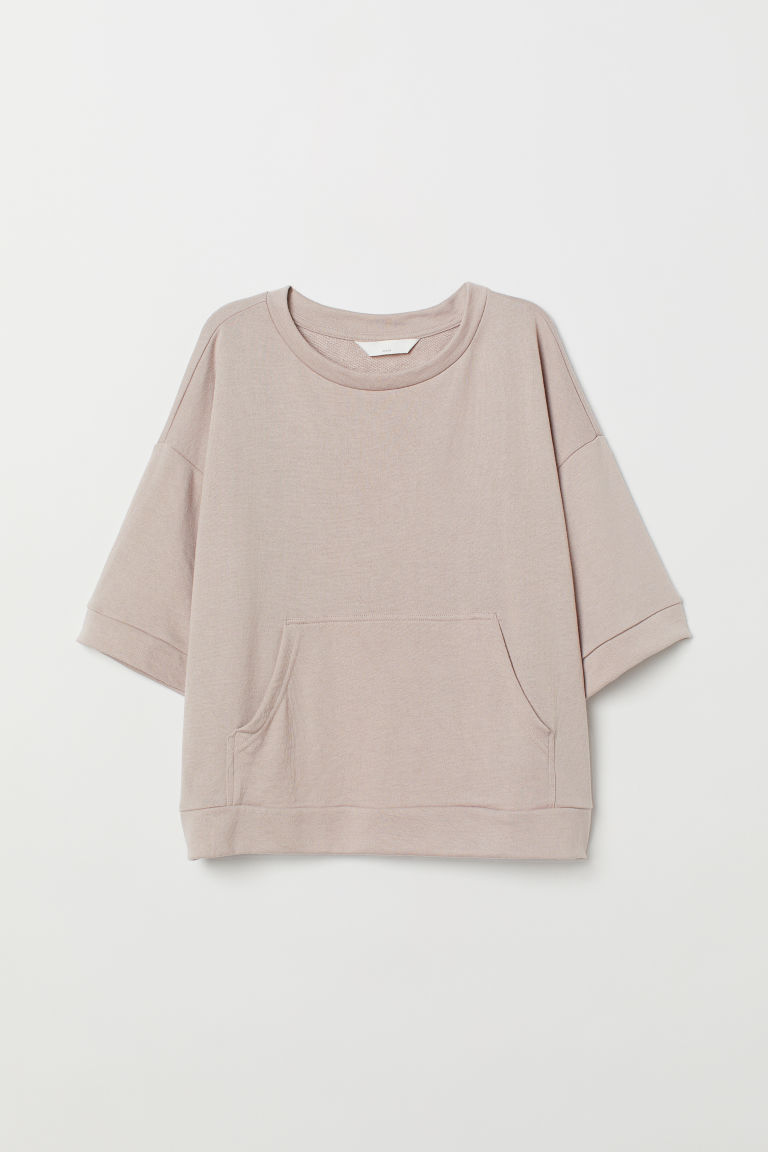 Short-sleeved sweatshirt - Light beige - Ladies | H&M