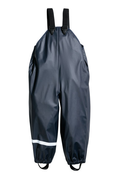 Rain trousers with braces - Dark blue - Kids | H&M
