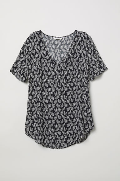 Top a maniche corte in viscosa - Nero/foglie - DONNA | H&M IT