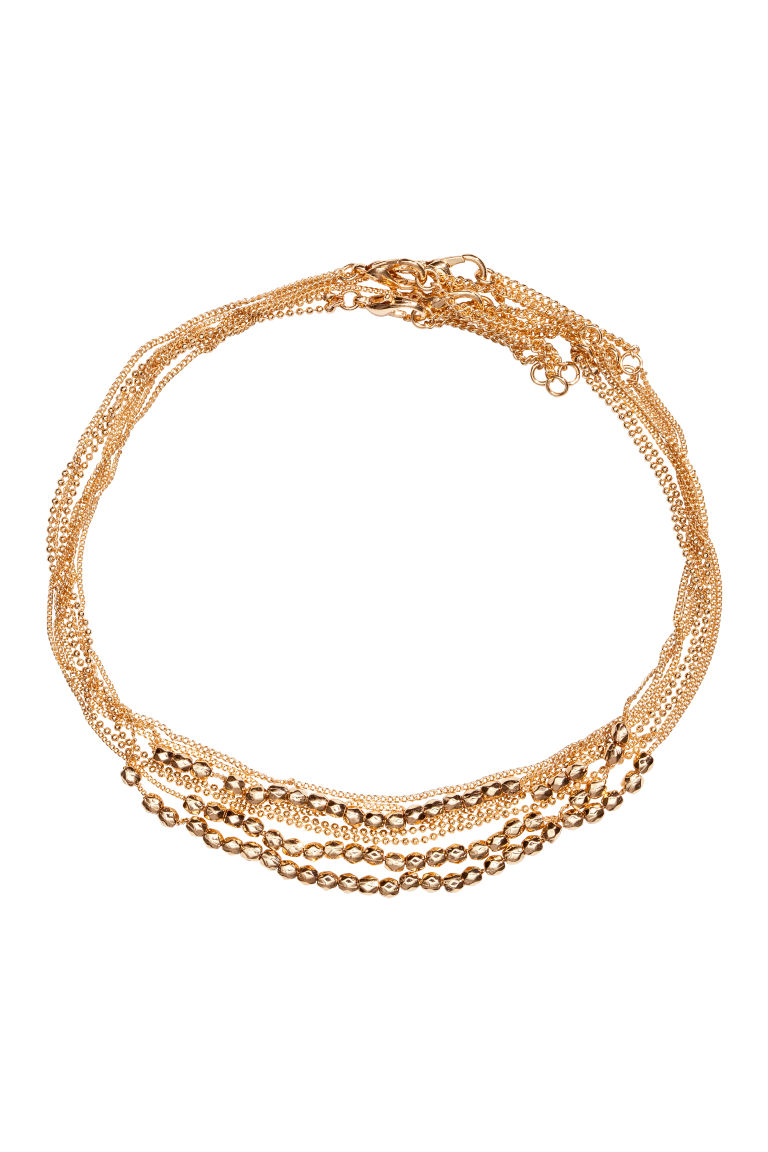 4-pack chokers - Gold-coloured - Ladies | H&M CN
