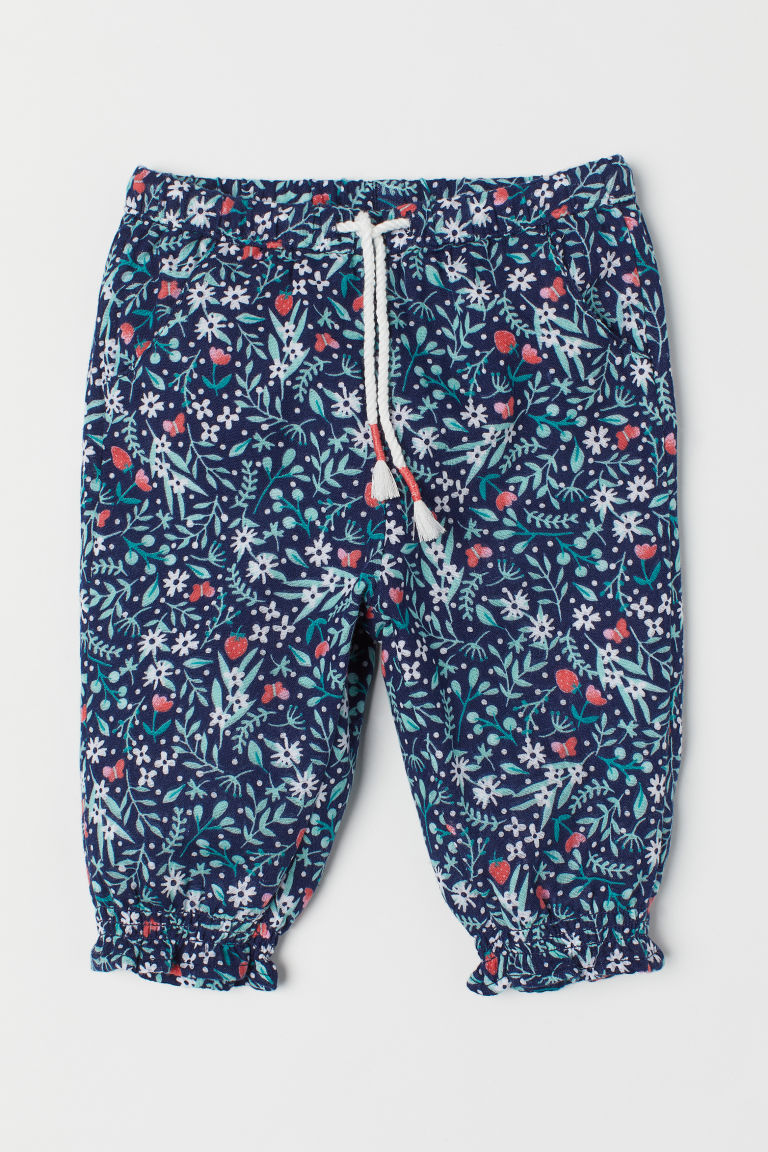 Pull-on trousers - Dark blue/Floral - Kids | H&M
